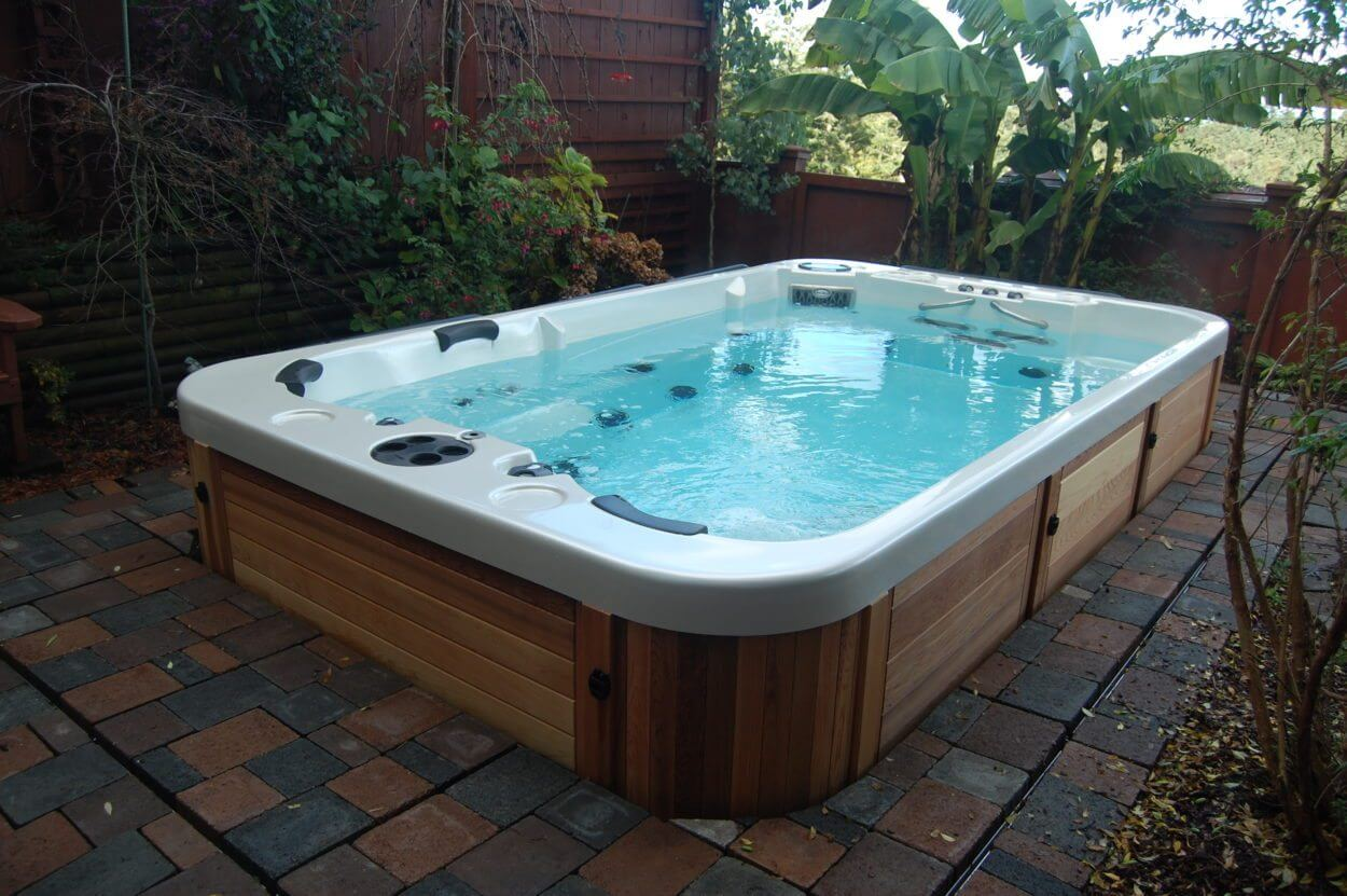 The many benefits of owning a swim spa hot tubs ontario for Swimming spa